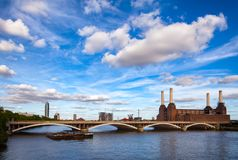 Abandonded Battersea Power Station and Grosvenor Bridge over the. Historical shot of decommissioned coal-fired Battersea power station, located on the south bank Stock Photo