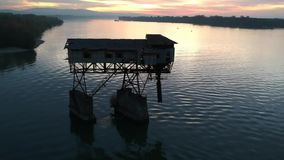 Abandonded coal transportation building on river. Danube stock video footage