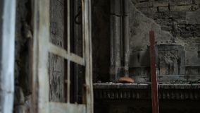 Abandonded crypt with broken rusty door stock footage