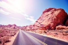 Abandone el camino contra el sol, imagen del concepto del viaje, los E.E.U.U. Fotos de archivo libres de regalías