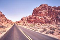 Abandone el camino en la puesta del sol, imagen del concepto del viaje, los E.E.U.U. Foto de archivo libre de regalías