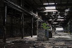 Abandoned. An abandoned factory shows major wear stock photos