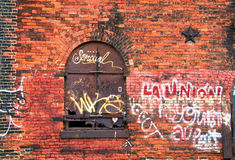 Abandoned. View of abandoned brick building with graffiti stock images