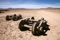 Abandoned. Train wheels at the train cemetery in the desert near Uyuni in Bolivia Royalty Free Stock Photos