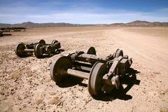 Abandoned. Train wheels at the train cemetery in the desert near Uyuni in Bolivia royalty free stock photos