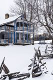 Abandoned Able Gabbard House in the Snow - Kentucky. A winter view of the abandoned Able Gabbard House near McKee, Kentucky. A rustic split rail fence is in the royalty free stock photo