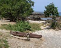 Abandoned aboriginal catamaran Stock Photo