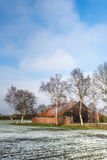Abandoned agricultural barn in wintertime Royalty Free Stock Photos