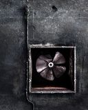 Abandoned air conditioning duct and rusted fan Royalty Free Stock Photos
