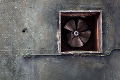 Abandoned air conditioning duct and rusted fan Royalty Free Stock Photography