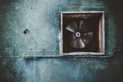 Abandoned air conditioning duct and rusted fan Stock Image