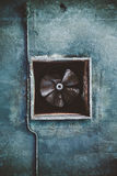 Abandoned air conditioning duct and rusted fan. Air conditioning duct and rusted fan on abandoned factory grunge ceiling royalty free stock image
