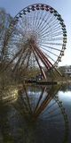 Abandoned Amusement Park Ferris Wheel. Old Ferris Wheel reflected in water Royalty Free Stock Photos