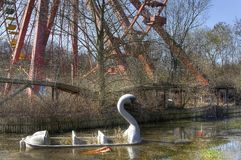 Abandoned amusement park with a Ferris wheel Stock Photos