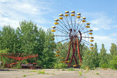 Abandoned amusement park in Pripyat. Abandoned ferris wheel in amusement park in Pripyat, Chernobyl area Stock Images