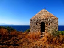 Abandoned ancient building, Zakynthos, Greece. Old guardhouse on the coast served as an observer Stock Photography