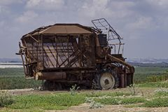 Abandoned Antique Cotton Picker on a Kibbutz in Israel stock photography