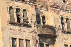 Abandoned apartment. Abandoned and deteriorated apartment from old brick house stock image
