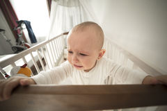 Abandoned baby in the crib crying Stock Photo