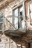 Abandoned balcony. Old abandoned balcony and window on stone made house.Syros island,Greece Royalty Free Stock Image