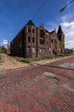 Abandoned Baptist Church and Red Brick Streets - McKeesport, Pennsylvania. A wide view of an abandoned Baptist Church with a sandstone facade along brick streets Royalty Free Stock Photography