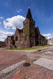 Abandoned Baptist Church and Red Brick Streets - McKeesport, Pennsylvania. A wide view of an abandoned Baptist Church with a sandstone facade along brick streets Stock Photos
