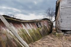 Collapsing abandoned barn with farmhouse stock images