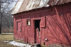 Abandoned Barn. With close up of peeling paint broken windows and doors and a roof that needs to be replaced Stock Photos