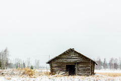 Abandoned Barn House. An old barn house covered in snow in the rural Finland stock photo