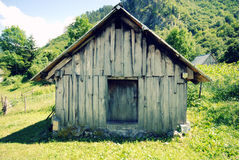 Abandoned barn in mountain countryside Stock Images