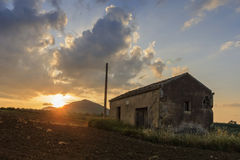Abandoned barn. An old abandoned barn in the countryside captured at sunset royalty free stock image