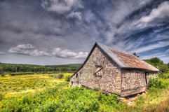 Abandoned barn, rural New Brunswick. A rustic barn in St. Martins, New Brunswick, Canada royalty free stock photos