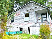 Abandoned Barn set in the woods. Of the Alaskan Outback country. North to Alaska abandonied old barn that needs repair royalty free stock photos