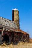 Abandoned Barn with Silo Royalty Free Stock Image