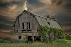 Abandoned barn with sunset sky. Dilapidated wooden barn in Michigan with a sunset sky background Royalty Free Stock Photo