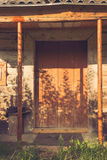 Abandoned barn vintage wooden door. Old photo of rustic house entrance Stock Photo