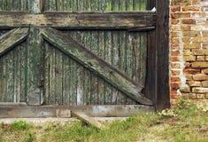 Abandoned Barn Wall. Abstract of abandoned barn door and brick wall stock photos