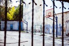 Abandoned Basketball court backyard Stock Image