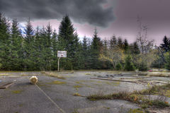 Abandoned basketball court. And trees Royalty Free Stock Image