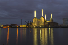 Abandoned Battersea power at night. Night view of abandoned Battersea power station across river Thames, London, UK Stock Image