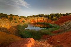Abandoned Bauxite mine. This lake was a Bauxite mineral used to produce aluminium mine until 1976, when it has been abandoned due to the infiltration of salted Stock Photography