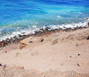 Abandoned beach with crystal clear azure sea in Greece Royalty Free Stock Image