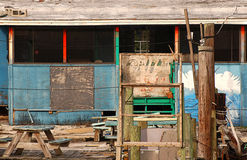 Old, abandoned beach shack on the water. Stock Photo