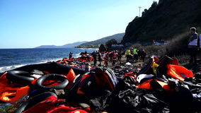Abandoned belongings and life jackets on the Lesvos shore.
