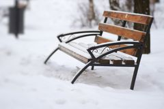 Abandoned bench covered with snow Stock Photos