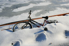 Abandoned bicycle. A bicycle is partly covered by snow stock photography