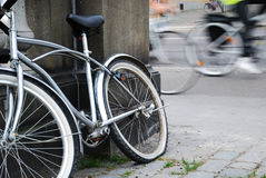 Abandoned bicycle against blurred cycle traffic Stock Image