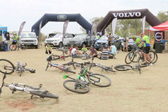 Abandoned Bicycles in front of luxury 4x4 motor car display at B Stock Photos
