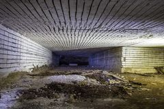 Abandoned big tunnel gallery of white limestone mine Stock Photo