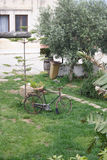 Abandoned bike in ostuni, italy. Abandoned bicycle in a garden in ostuni, italy Stock Photos